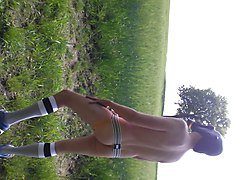 german skater boy outdoor with jock tube socks and gasmask