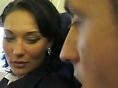 brunette beauty wearing stewardess uniform gets fucked on a plane